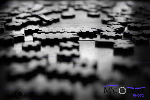 Stock Photograph - Puzzle pieces in black and white