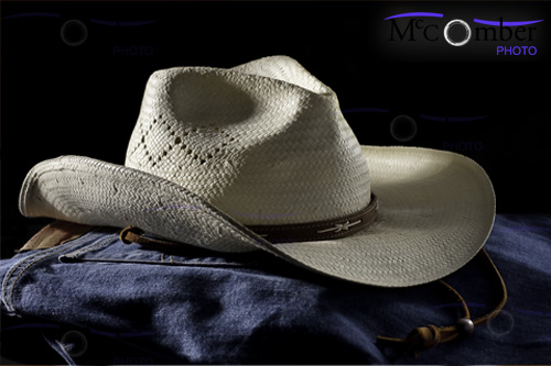 Cowboy hat on blue jeans