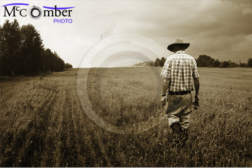 Lone Farmer Walks into his misty field