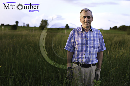 Senior man in a field at sunset