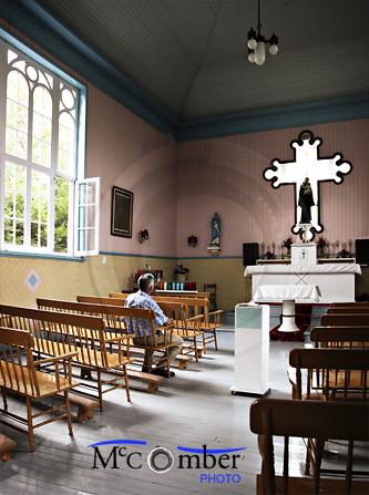 Senior man sitting in a chapel