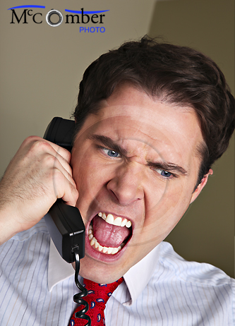 Businessman yells into phone