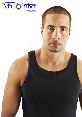 Serious muscular man in tank top