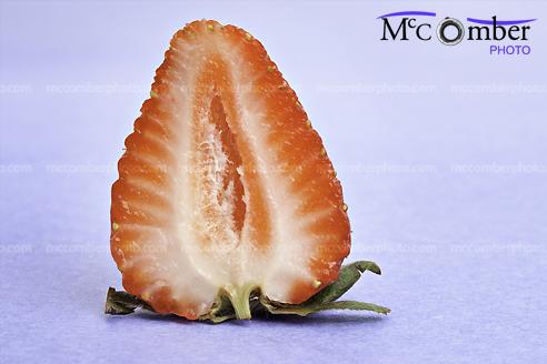 Sliced strawberry on blue background