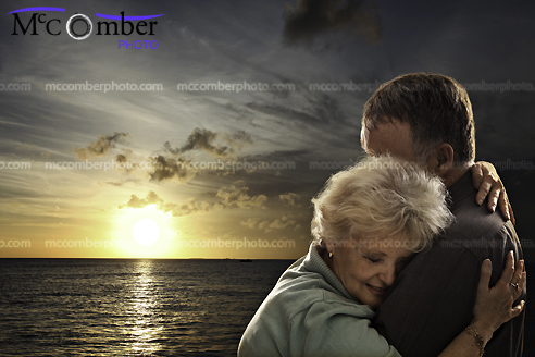 Senior Couple Embracing in Front of Sunset