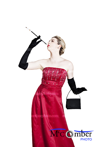 Elegant woman in a red dress poses with cigarette