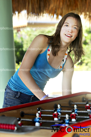 Stock photo: Female teenager playing Foosball