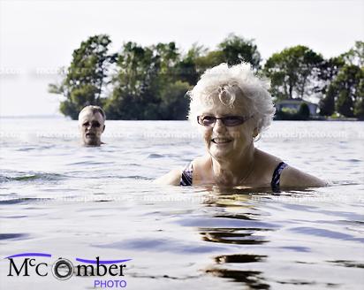 Senior woman swimming in lake