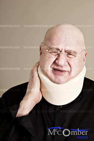 Bald senior man with neck injury