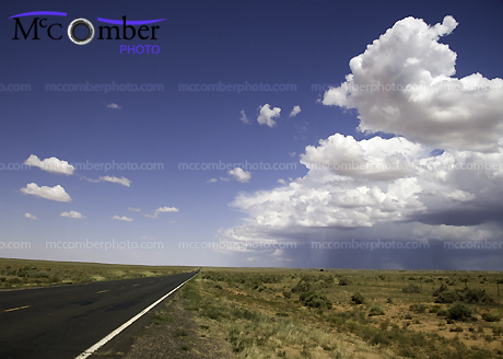 Road in Arizona desert with storm approaching