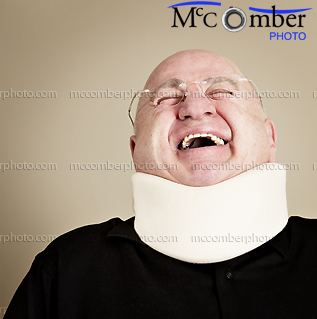 Bald man with neck brace laughing