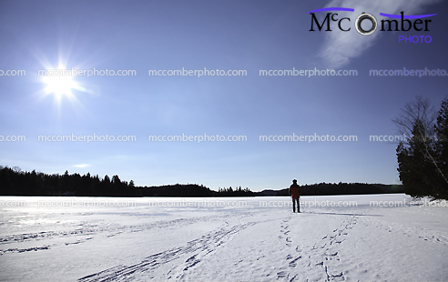 Hiker on a frozen lake in the Lanaudière area