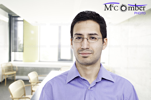Hispanic Office Man With Glasses In Conference Room