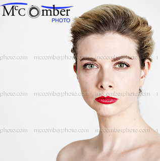 Stock photo: Beautiful woman with updo looking fiercely mad
