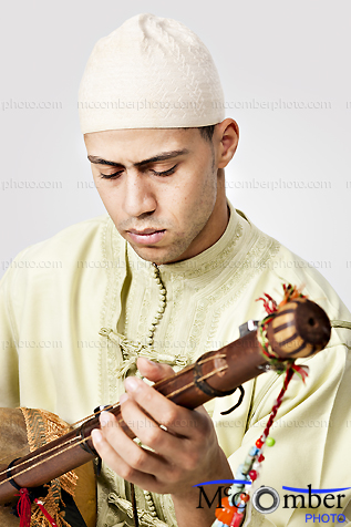 Stock photo: Moroccan man playing the Guembry