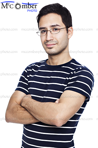 Stock photo: Proud young Hispanic gay man with arms folded and glasses