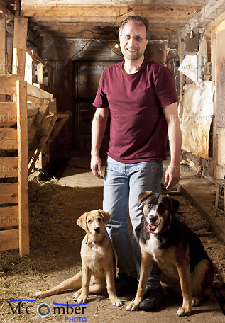 Stock photo: Farmer in barn with his two dogs