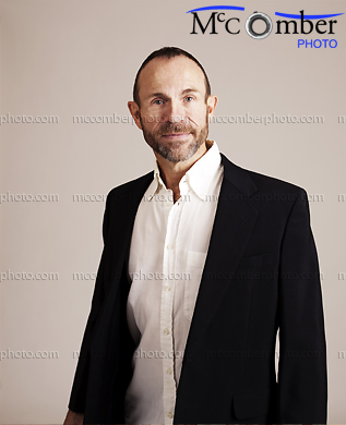 Stock photo: Mature man in black jacket smiling
