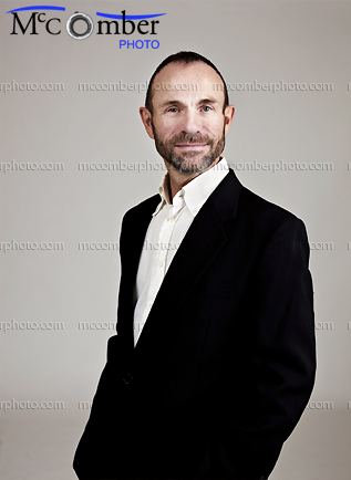 Stock photo: Relaxed mature man in black jacket