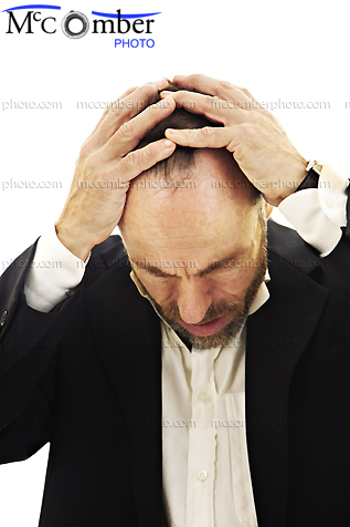 Stock photo: Mature man holding his head in despair
