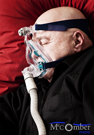 Stock photo: Profile of a bald senior man sleeping with Cpap mask