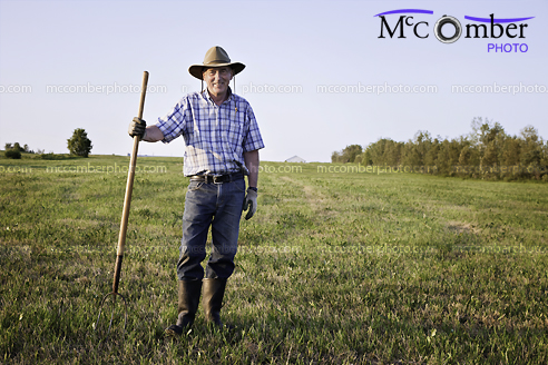 Stock Photo: Senior farmer standing in field full length