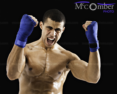 Stock photo: Muscular man with training gloves screaming