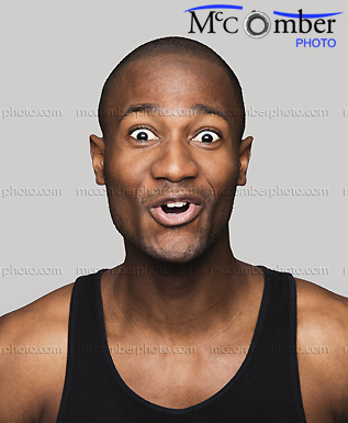 Stock Photo: Black man surprised and delighted