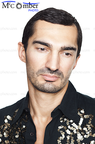 Stock Photo: Head Shot of a Frenchman with thick eyebrows looking down sad