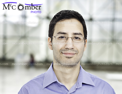 Featured Stock Photograph - Responsible Hispanic Office Worker in Modern Hall