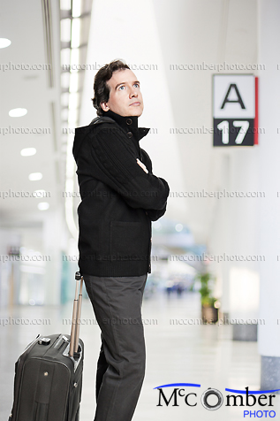 Stock Photograph - Patient Man waiting in Airport