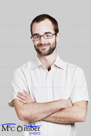 Stock Photograph - Young Adult Worker with summer shirt, arms crossed