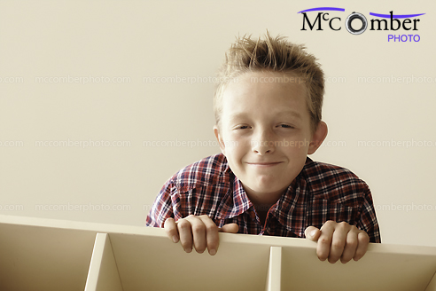 Stock Photo - Mischievous kid sneaking up from above
