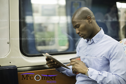 Stock Photo - Businessman in the subway with tablet