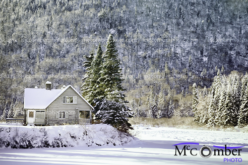 Stock Photograph - Winter landscape with cabin and frozen River