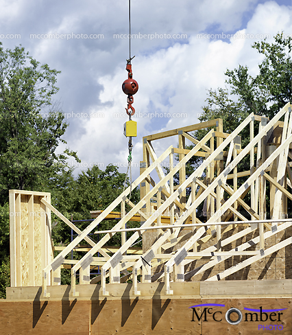 Stock Photograph: Lowering Roof Truss Residential Construction