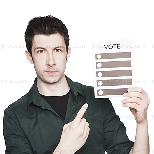 Stock photo: Serious young man points to voting ballot