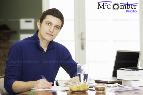 Stock Photograph - Handsome Young Male Student working at home