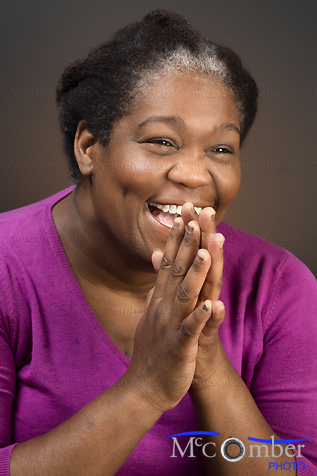 Featured Stock Photograph - Ecstatic Black Mature Woman Laughing