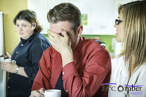 Stock Photograph - Insensitive coworker can't help laughing at embarrassing colleague