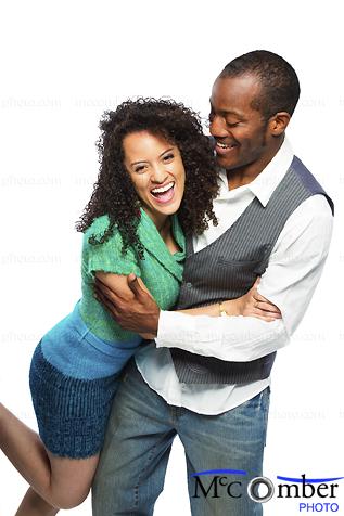 Stock Photo : Beautiful Young Ethnic Couple Having Fun Isolated