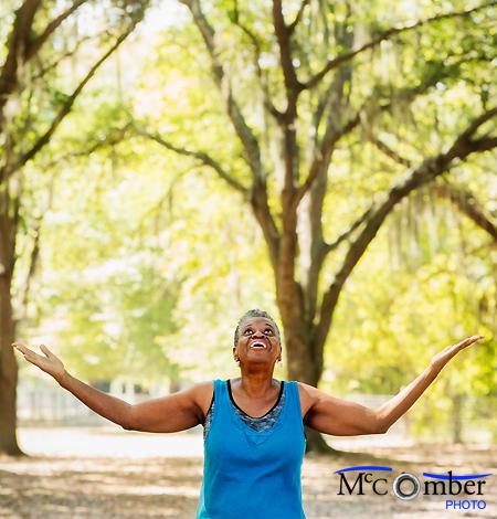 Stock Photograph - Senior Black Woman Thankful For Beautiful Florida Nature