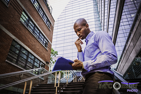 Stock Photo: Businessman preparing report by himself outdoors