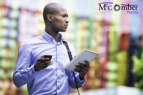 Stock photo: Businessman with tablet and smart phone looking away