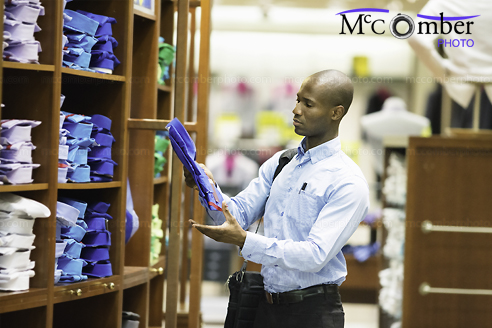Stock Photo: Businessman shopping for shirts