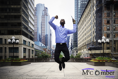 Stock Photo: Successful Businessman jumps with joy Downtown Montreal