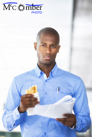 Stock Photo: Handsome Black Businessman with lunch outdoors