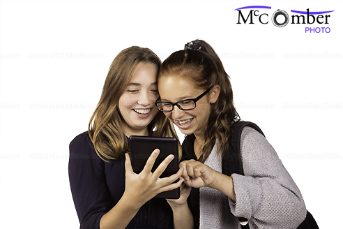 Back to School: Two teenage girls enjoy mini tablet