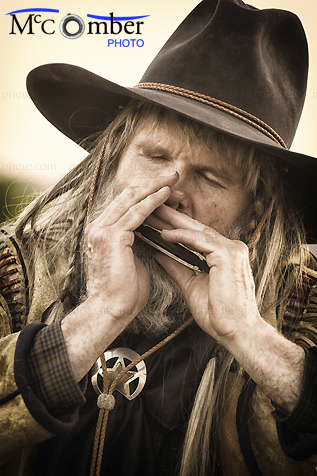 Stock Photo - Wild West Man Playing Harmonica
