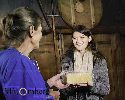 Stock Photo: Fair trade purchase of Swiss cheese at the farm